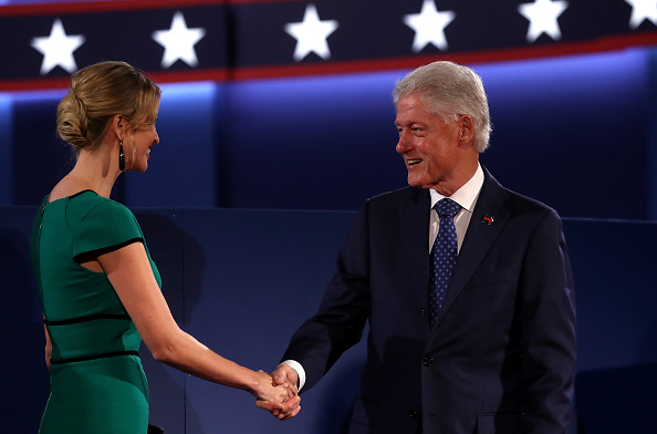 Ivanka Trump shakes Bill Clinton's hand after Mr Trump's surprise press conference. Photo: Getty