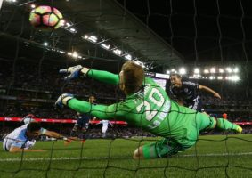 Victory goalkeeper Lawrence Thomas is beaten by a shot from Bruno Fornaroli.