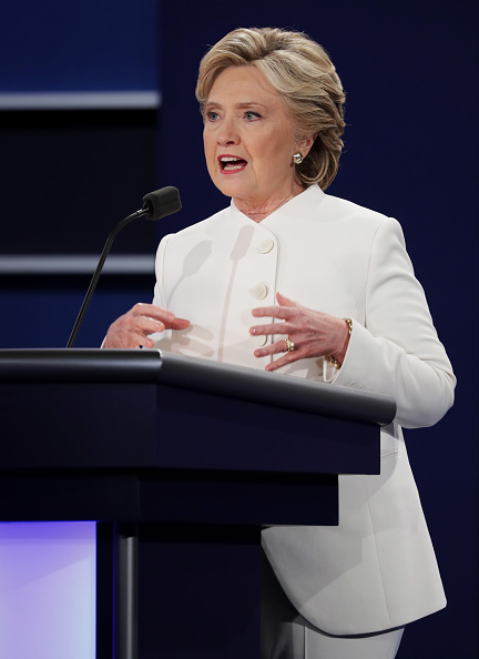 Ms Clinton channeled an angelic look in all white. Photo: Getty