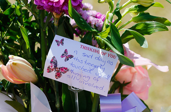 Members of the public left bouquets outside the Dreamworld gates. Photo: Getty