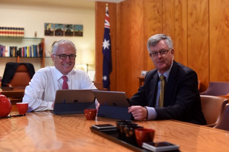 Prime Minister Malcolm Turnbull speaks to the Secretary of Prime Minister and Cabinet Martin Parkinson