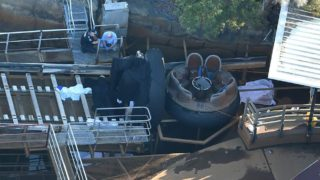 Emergency services personnel at the scene of the accident at Dreamworld.