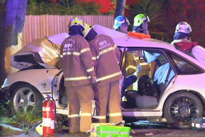 Two passengers trapped in the car had to be freed by emergency services.