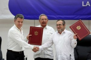 Colombia's President Juan Manuel Santos and FARC leader Timochenko. Photo: ABC