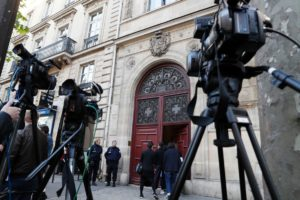 Media outside Kim Kardashian's private residence in Paris, where the robbery took place.