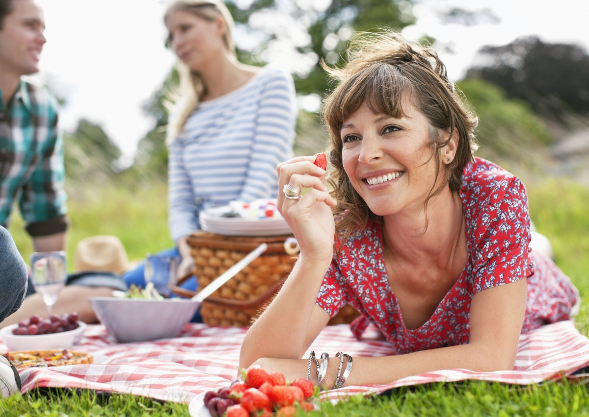 Having a picnic with friends is the perfect way to get some Vitamin D and have some fun. Photo: Getty