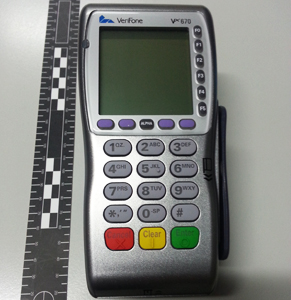 This compromised eftpos machine was seized by police from a Sydney taxi in 2014. Photo: AAP