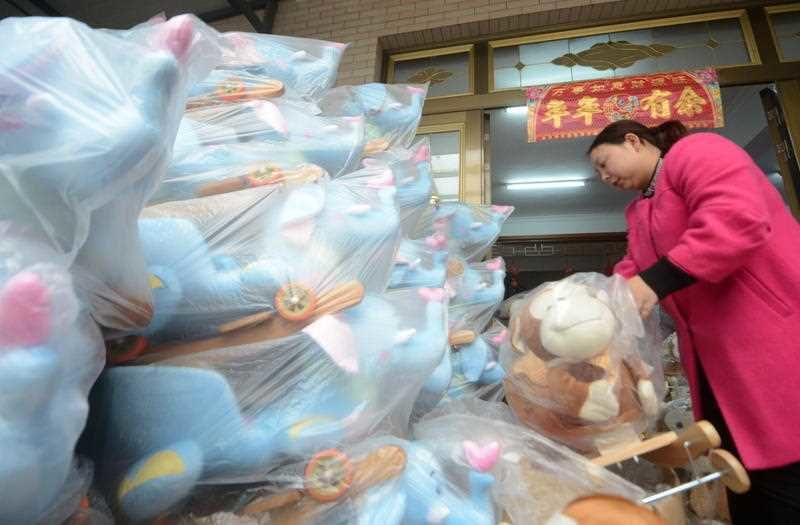 A worker packages toys for the November 11 Singles Day shopping festival at a factory in Yangzhou city. Photo: AAP.
