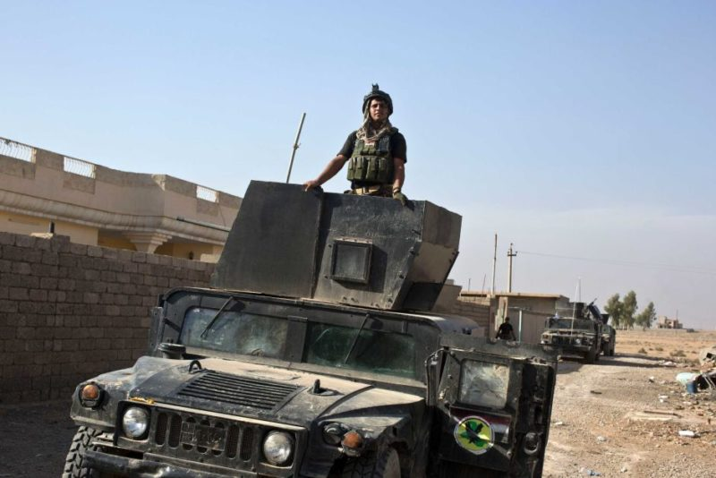 An Iraqi special forces soldier stands atop a Humvee in the village of Bazwaia, eight kilometres from the centre of Mosul.