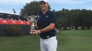 Jordan Spieth with the Australian Open trophy