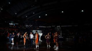 Taipans and Bullets players stand on court during a blackout in the final quarter of their clash.