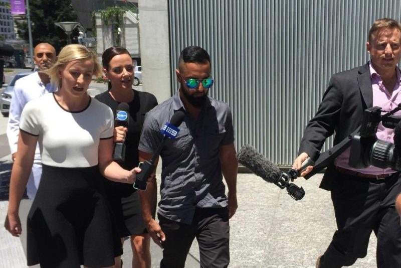A supporter of Omar Succarieh leaves the Supreme Court in Brisbane.