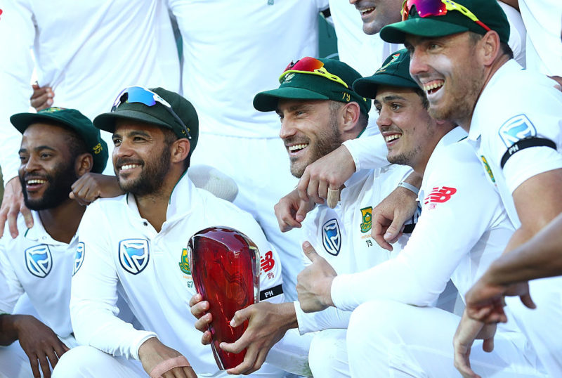 Faf du Plessis and the South African team celebrate with the trophy for winning the series.