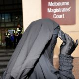 A family member leaves the Melbourne court precinct.