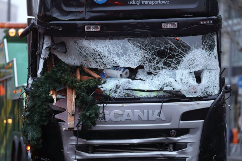 The shattered windshield of a truck after it ploughed through a Christmas market in Berlin.