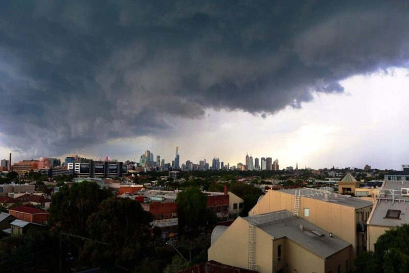 Storm clouds gather over Melbourne before a deluge.