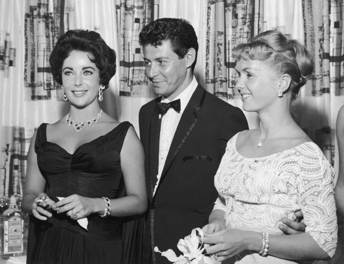 Reynolds (right) with her former husband Eddie Fisher (centre) who had an affair with her friend, Elizabeth Taylor (let). Photo: Getty