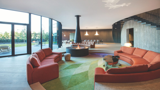 The large, open living room features an open fire place. Photo: Domain