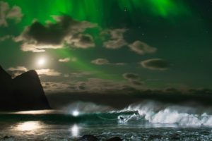 Mick Fanning surfing northern lights