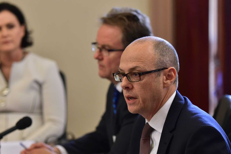 Tony Cudmore (R) and Phil Edmands (L)) address the Senate inquiry into Tax Avoidance at Parliament in Melbourne.