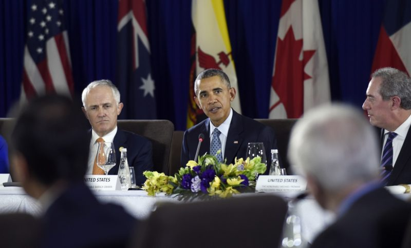 President Barack Obama, center, sitting next to Australia's Prime Minister Malcolm Turnbull, left, and U.S. Trade Representative Michael Froman, right, speaks during a meeting with other leaders of the Trans-Pacific Partnership countries in Manila, Philippines