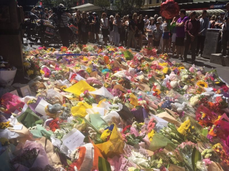 Hundreds of flowers, teddy bears laid in tribute to the Bourke St victims. Photo: Twitter.