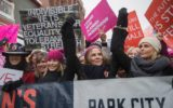 Actresses Chelsea Handler (left) and Charlize Theron (right) participate in the Women's March during the 2017 Sundance Film Festival.