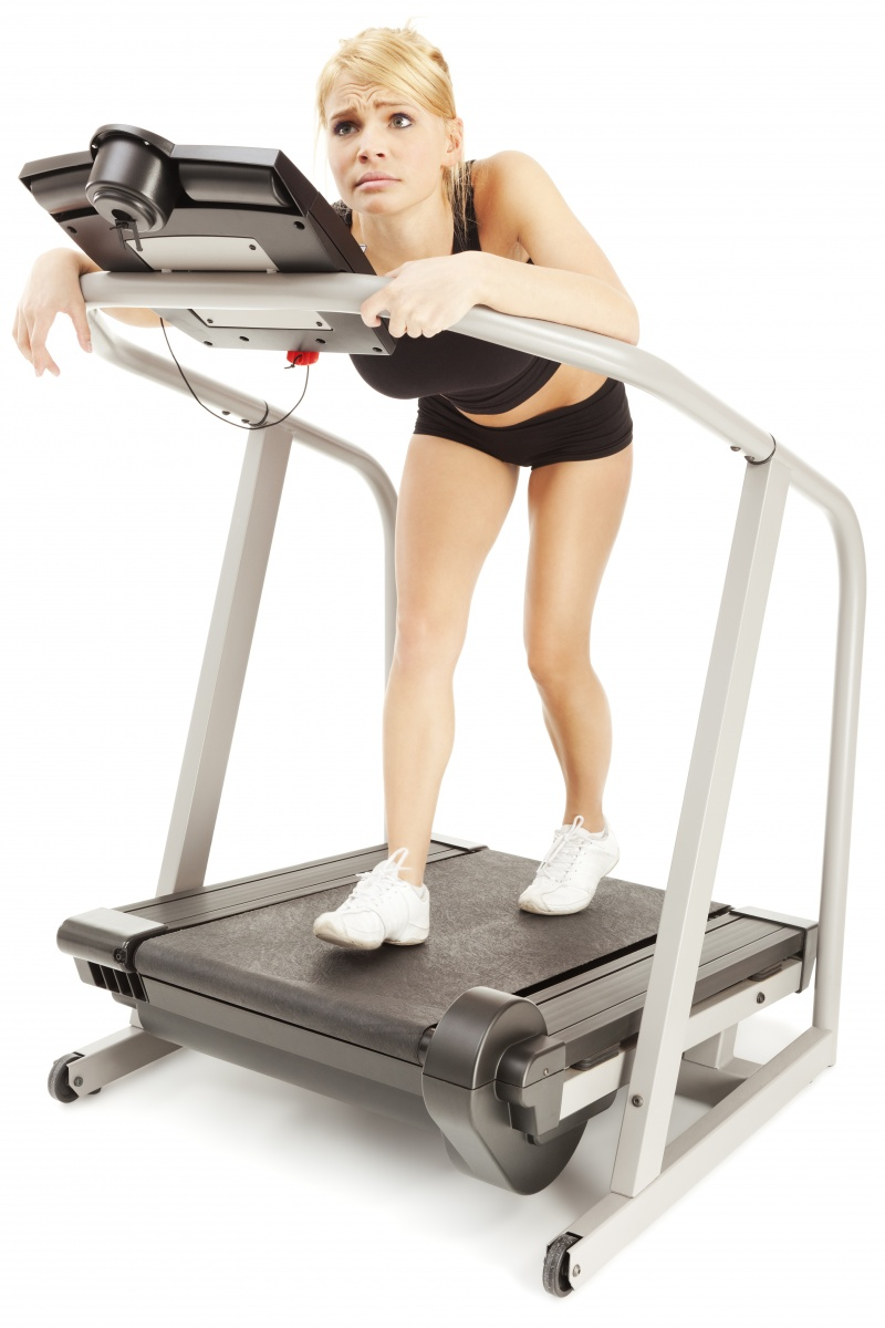 Happy woman on treadmill