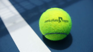 An Italian junior player has bowed out of the Open after she was disqualified in the first round.