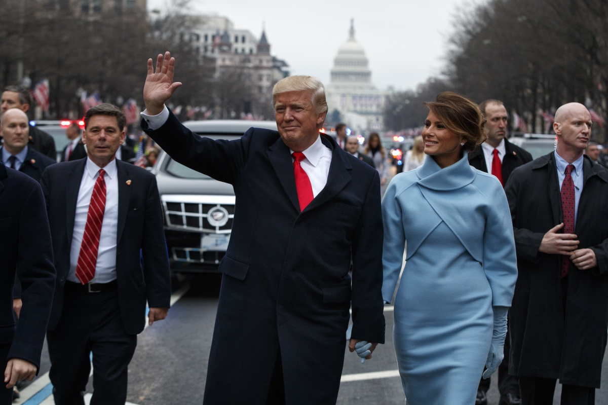 The President and First Lady wave to supporters along the parade route. Photo: Getty
