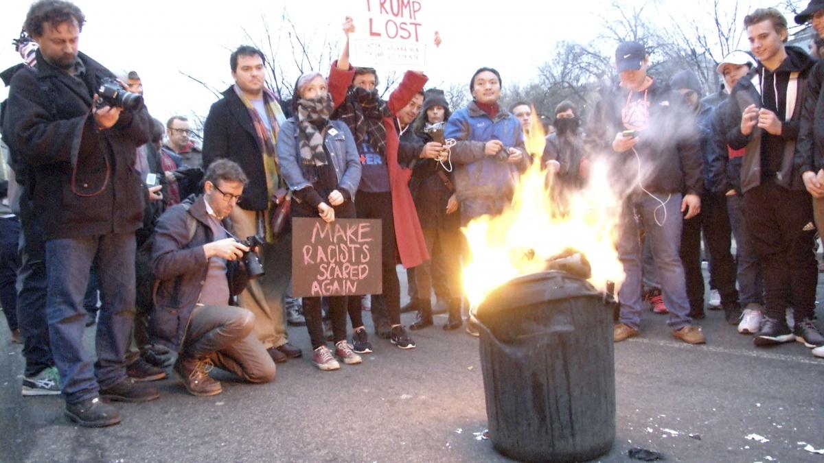 Protestors burn a bin