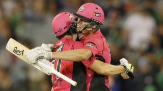 Ben Dwarshuis and Sean Abbott celebrate steering the Sydney Sixers to victory and a semi-final berth.