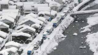Hundreds of cars are stranded due to heavy snow on a road in western Japan.
