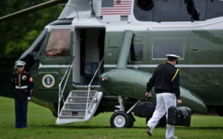 "A soldier and the nuclear ""football"" stay close to the President at all times"