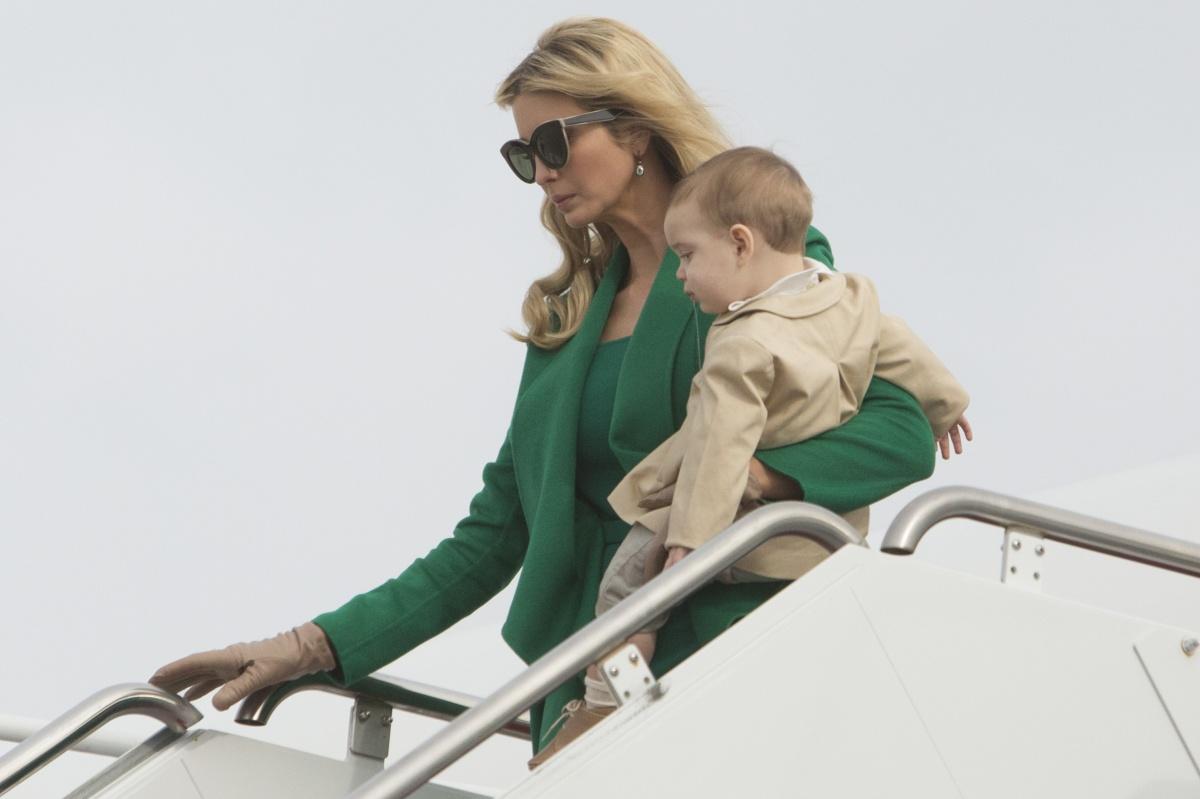 Ivanka Trump's airport arrival was the height of glamour - even with a baby on her hip. Photo: Getty