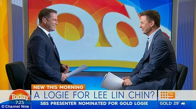Karl Stefanovic (left) and Ben Fordham happily face off wearing similar suits.