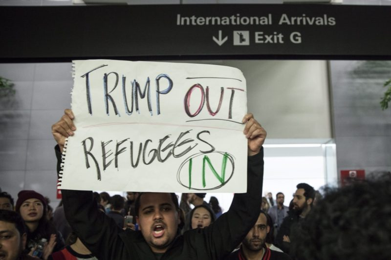 People gather for a protest at the Arrivals Hall of San Francisco's SFO International Airport