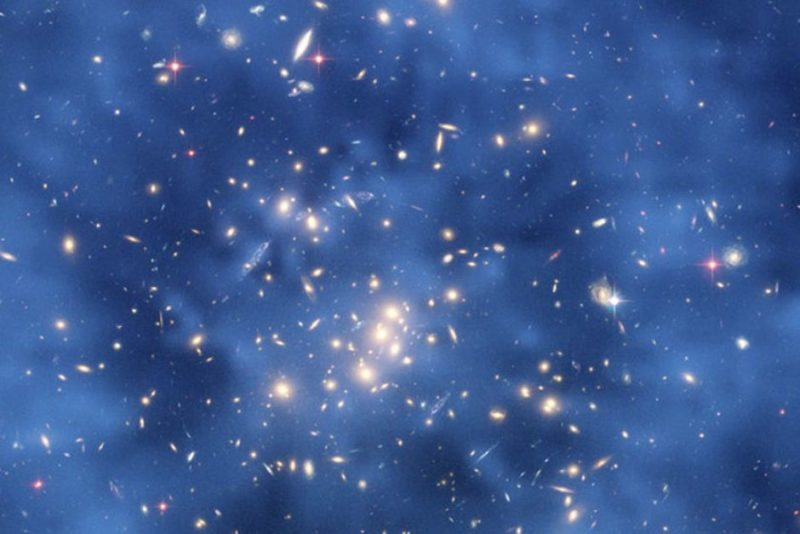 An image from Hubble Space Telescope shows ring of dark matter in a galaxy cluster.