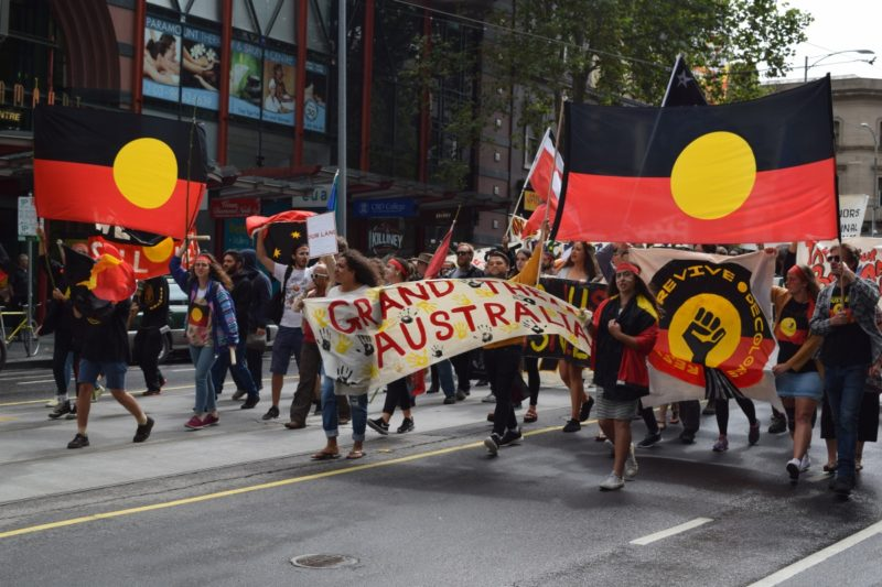 Hundreds of protesters marching against the celebration of Australia Day. Photo: Newzulu