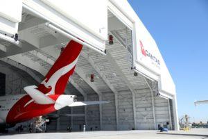 Qantas profit hit
