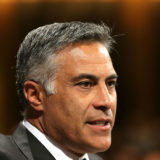 The Australia Post board has defended Ahmed Fahour's $5.6 million package.