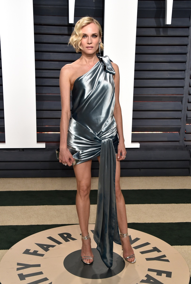 Diane Kruger showed some leg in a draped silver gown.