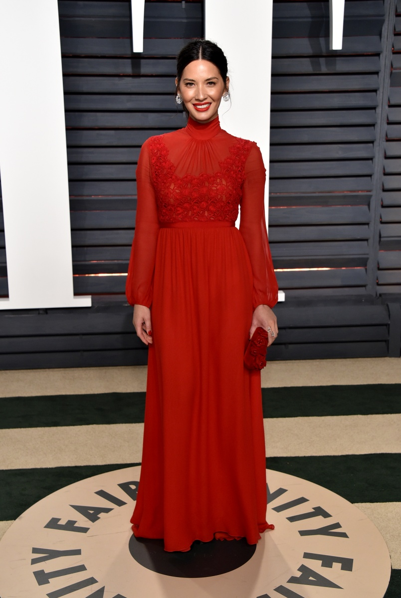 Olivia Munn kept it conservative in red.