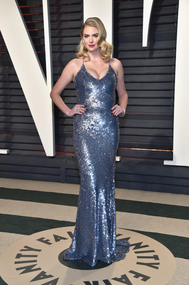 Kate Upton is full va va voom in blue sequins.