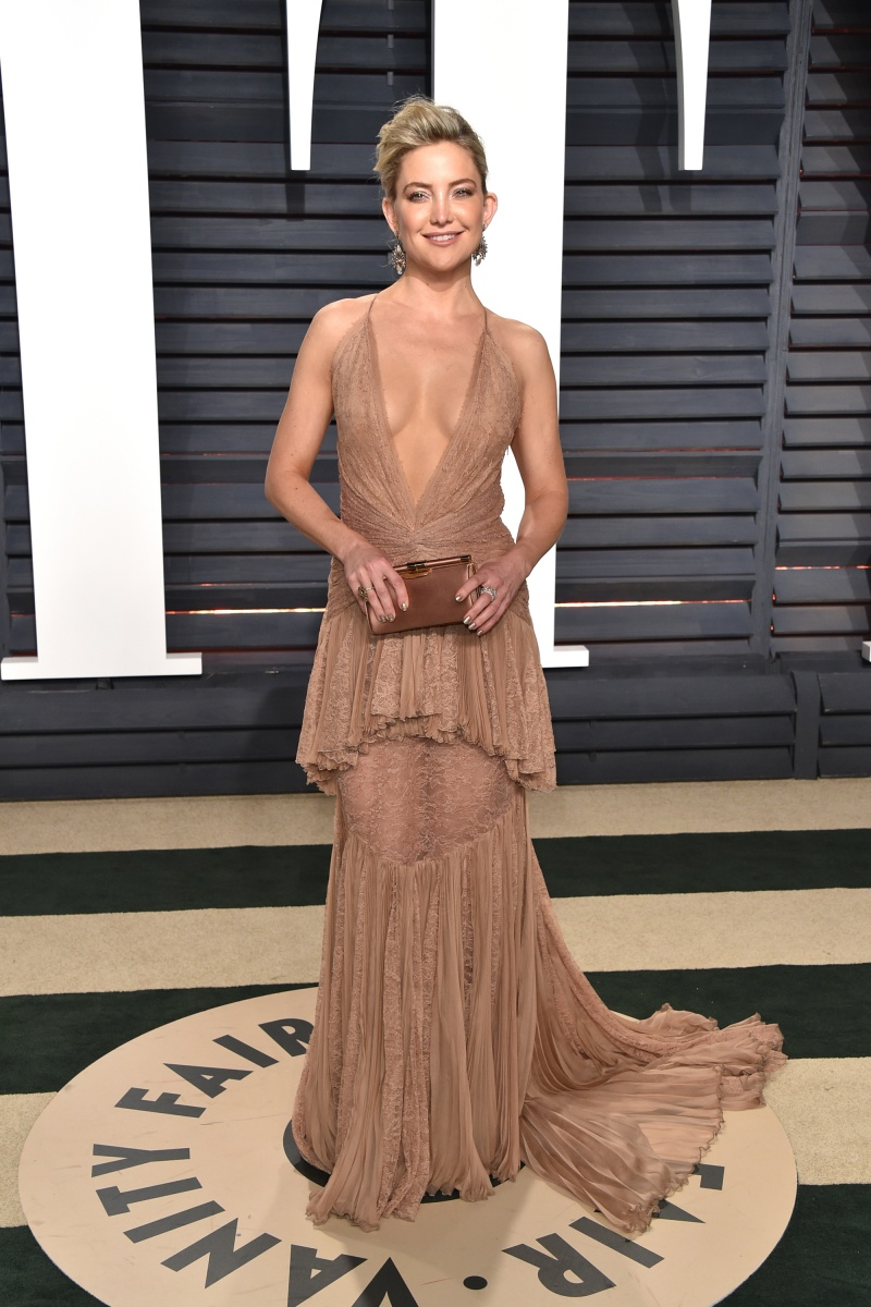 Kate Hudson shows some skin in a nude gown.