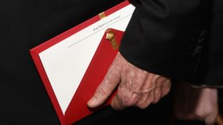 Presenter Warren Beatty holds the envelope containing the wrong award announcement for Best Picture at the Oscars.