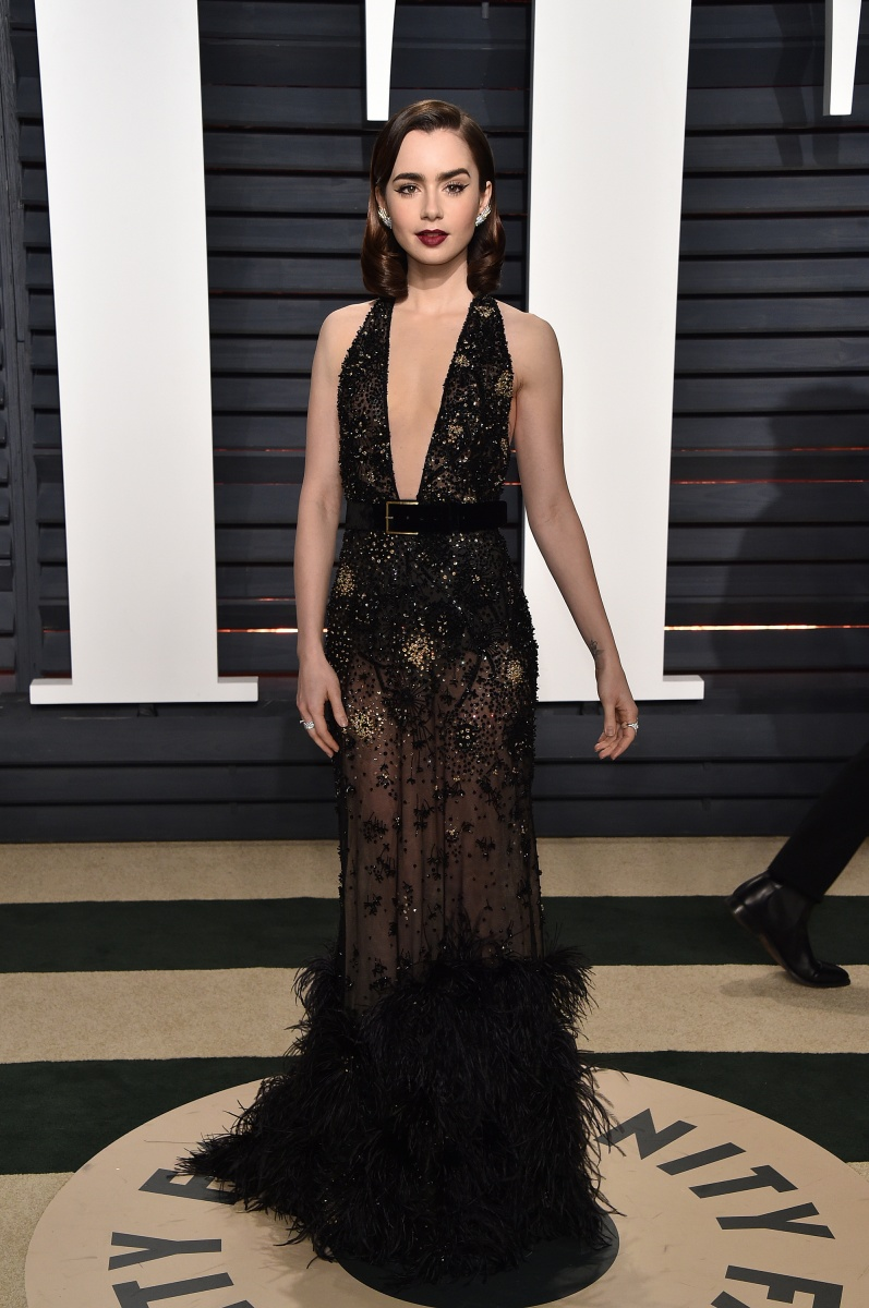 Lily Collins wore a low-cut flapper-inspired frock.