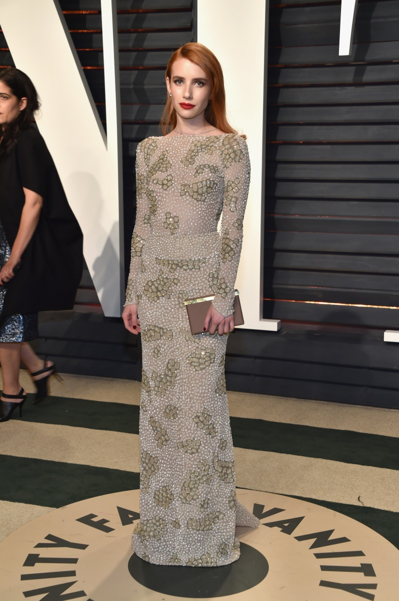 Emma Roberts swapped her black and white dress at the ceremony for a muted, long-sleeved gown.