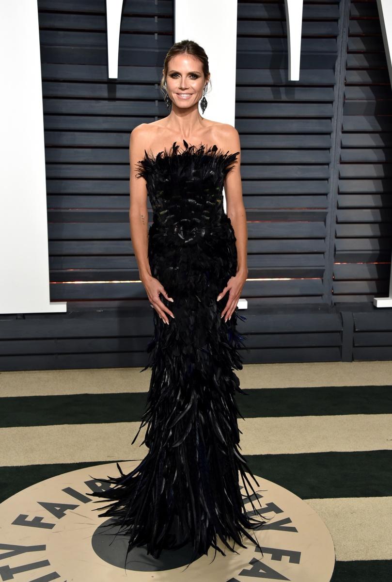 Heidi Klum wears a frothy black frock.