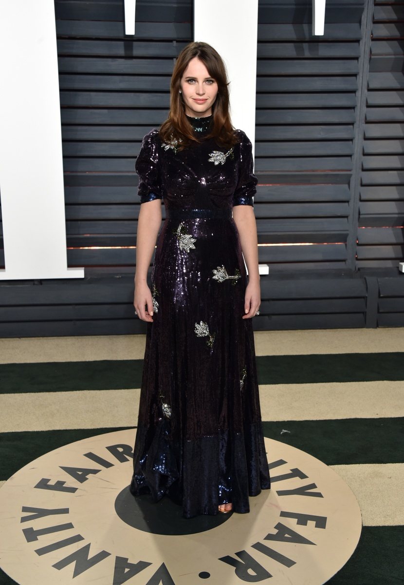 Felicity Jones disappointed in this frumpy number.